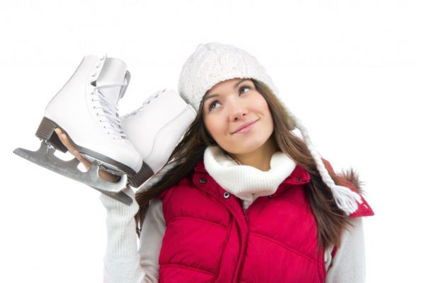 Pretty woman with ice skates winter
